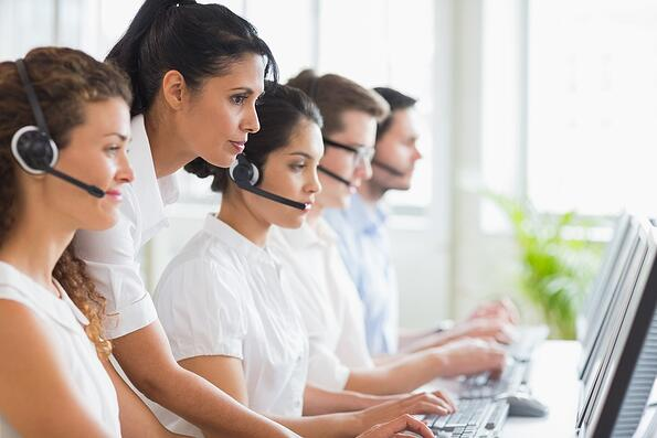 Side view of female manager assisting her staffs in a call center
